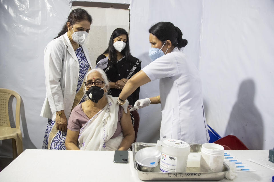 Anjali Sarma, 80, receives COVISHIELD vaccine at the Guwahati Medical College hospital in Gauhati, India, Monday, March 1, 2021. India is expanding its COVID-19 vaccination drive beyond health care and front-line workers, offering the shots to older people and those with medical conditions that put them at risk. (AP Photo/Anupam Nath)