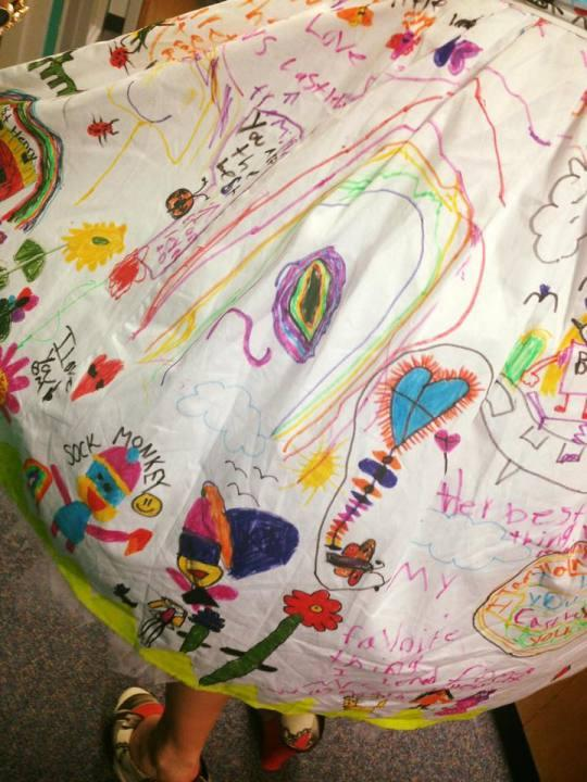 A close-up of the dress decorated with the students' artwork. (Photo: Facebook/ShaRee Castlebury)