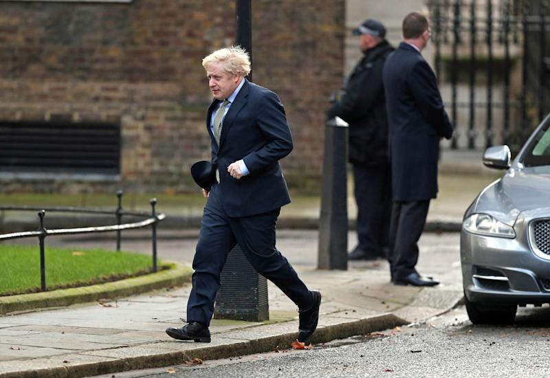 Boris Johnson arrives in Downing Street after an audience with Queen Elizabeth II in which he was invited to form a Government after the Conservative Party was returned to power in the General Election with an increased majority. PA Photo. Picture date: Friday December 13, 2019. See PA story POLITICS Election. Photo credit should read: Andrew Matthews/PA Wire