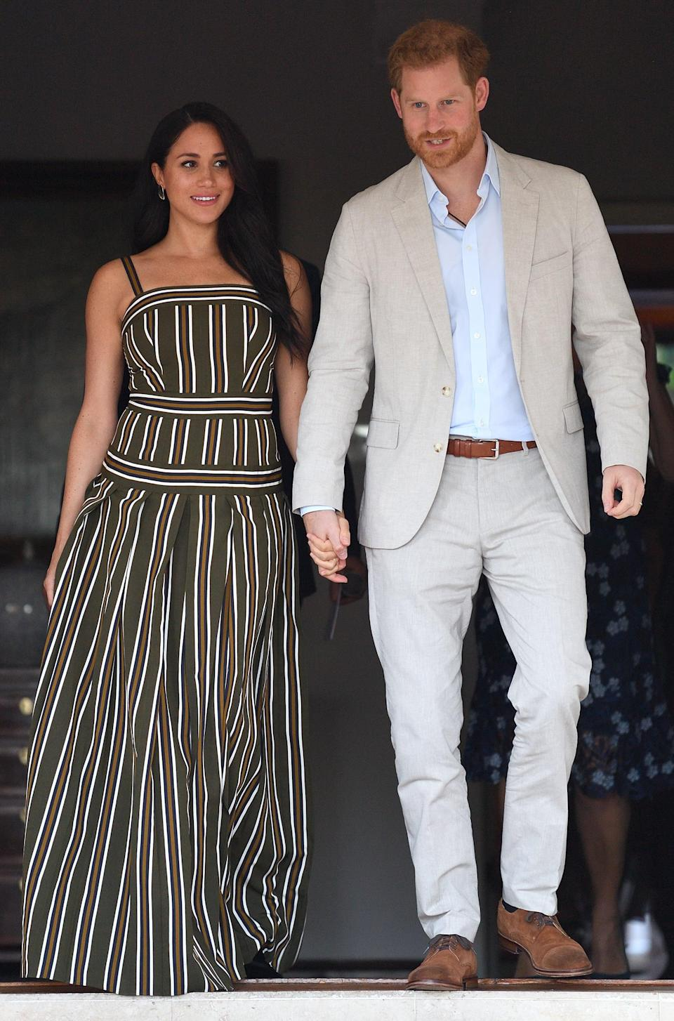 """<p>Meghan's Southern Africa tour was all about repeat outfits, as she wore <a href=""""https://www.popsugar.co.uk/fashion/photo-gallery/46669039/image/46682017/Meghan-Duchess-Sussex-Wears-Striped-Maxi-Dress"""" class=""""link rapid-noclick-resp"""" rel=""""nofollow noopener"""" target=""""_blank"""" data-ylk=""""slk:the same Martin Grant maxi dress yet again"""">the same Martin Grant maxi dress yet again</a> while visiting the Residence of the British High Commissioner during her royal tour of Cape Town, South Africa, in September 2019.</p>"""