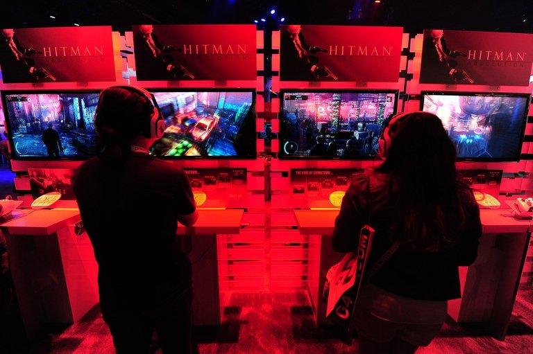Gaming fans play Playstation 3's Hitman Absolution in Los Angeles on June 7, 2012