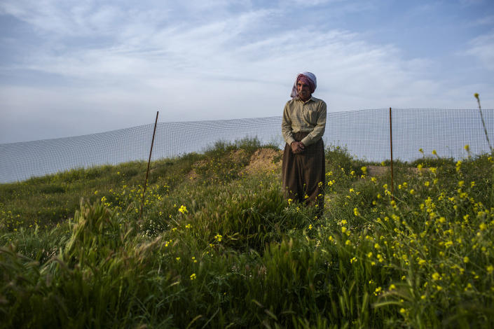 <p>Rashu, a Yazidi who saw a mass killing, looks at a mass grave in Hardan at West of the Intersection in Sinjar Province, April 7, 2016. According to witnesses, ISIS got inside the town, took the people and massacred them. The number of men killed remains unknown but almost 200 are still missing. (Photograph by Diego Ibarra Sanchez / MeMo) </p>