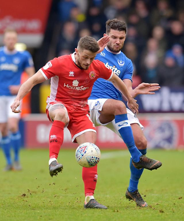 "Soccer Football - League One - Walsall vs Portsmouth - The Banks's Stadium, Walsall, Britain - March 31, 2018 Walsall's Flo Cuvelier in action with Portsmouth's Gareth Evans Action Images/Paul Burrows EDITORIAL USE ONLY. No use with unauthorized audio, video, data, fixture lists, club/league logos or ""live"" services. Online in-match use limited to 75 images, no video emulation. No use in betting, games or single club/league/player publications. Please contact your account representative for further details."