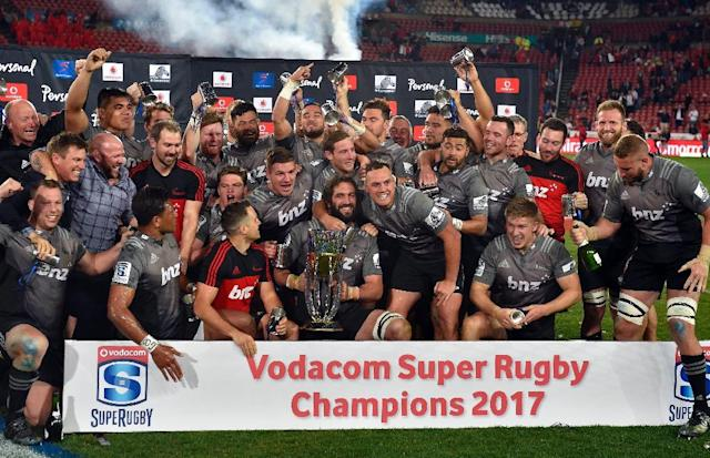 Canterbury Crusaders celebrate their Super Rugby final victory against Golden Lions in Johannesburg last August (AFP Photo/CHRISTIAAN KOTZE)