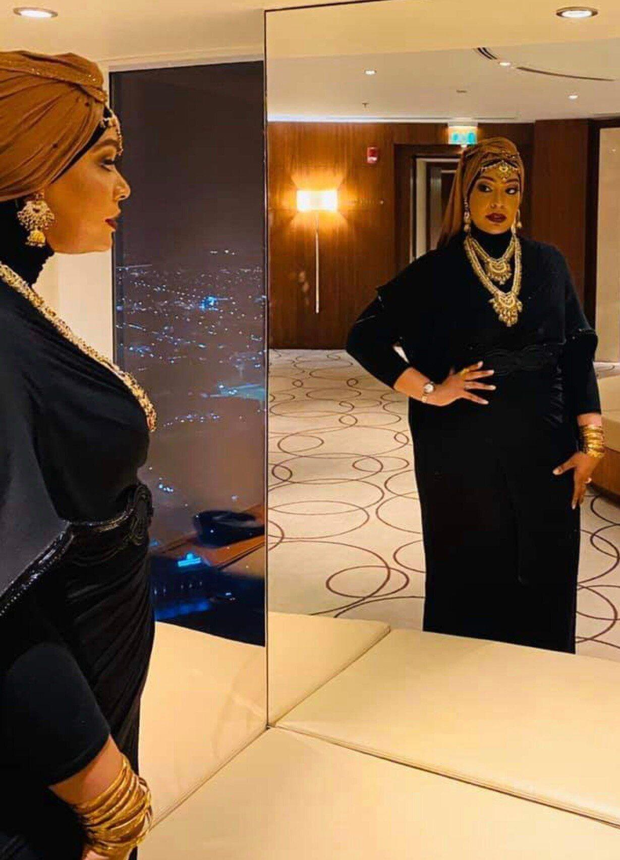 """""""I really used to struggle with the thought of wearing a scarf full-time because so much of my beauty was wrapped up in my hair,"""" says Khalid."""