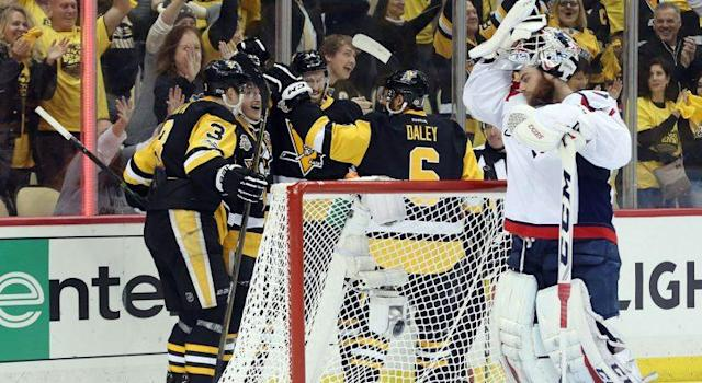 Washington Capitals goalie Braden Holtby (70) reacts as the Pittsburgh Penguins celebrate a goal by center Jake Guentzel (59) during the second period. (Charles LeClaire-USA TODAY Sports)