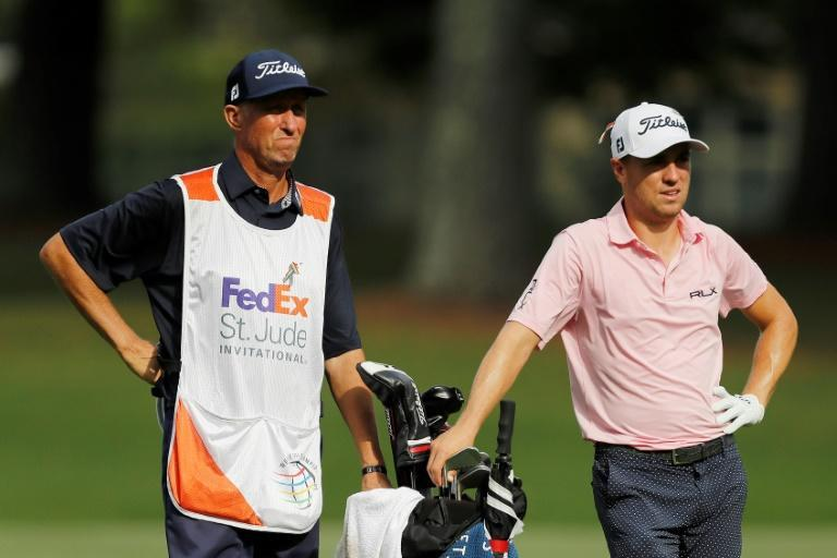 "Instant hit: Justin Thomas and stand-in caddie, Jim ""Bones"" Mackay, who carried the bag for Phil Mickelson for 25 years (AFP Photo/Michael Reaves)"