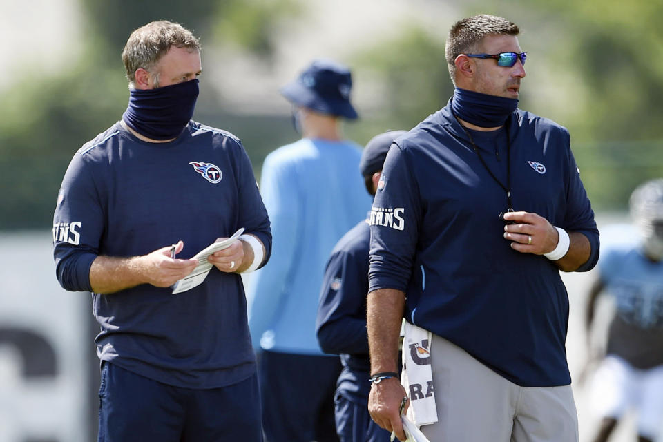 Titans outside linebackers coach Shane Bowen, left, and head coach Mike Vrabel watch players.