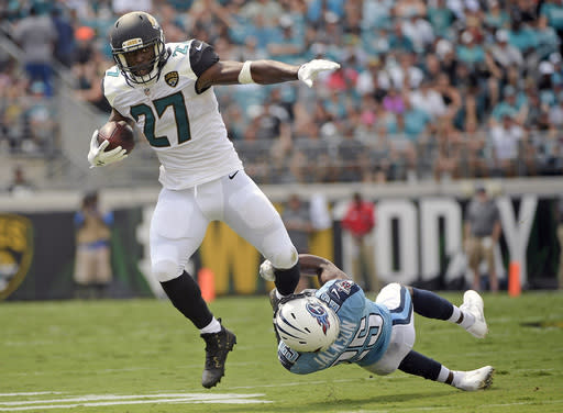 The show went on for Leonard Fournette and the Jaguars on Sunday, a blowout loss to the Titans. (AP)