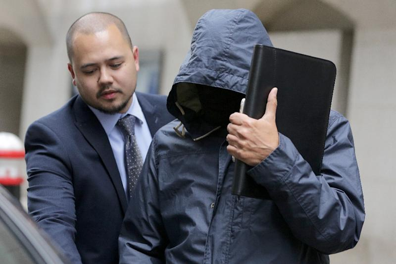 Mazher Mahmood (right), a British journalist known as the Fake Sheikh, leaves the Central Criminal Court in central London, on September 19, 2016