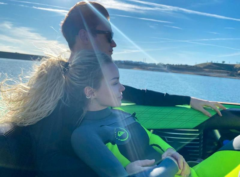 Dove Cameron and Thomas Doherty on a boat