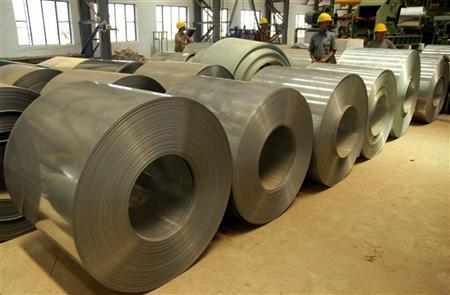 Labourers work inside a steel factory on the outskirts of Agartala