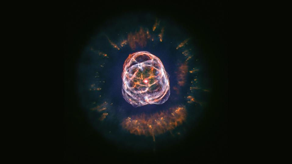 "The planetary nebula NGC 2392, also known as the ""Eskimo Nebula,"" is the colorful remnant of a star that died about 4,200 light-years from Earth, leaving behind a brilliant orb of intricate layers and patterns. This star didn't die in a supernova explosion, but rather burned up all of its fuel, causing it to cool, expand and shed its outer layers. This image combines data collected via NASA's Chandra X-ray Observatory and the Hubble Space Telescope in 2013, and citizen scientist Kevin Gill recently reprocessed the image to bring out the nebula's detailed structure."