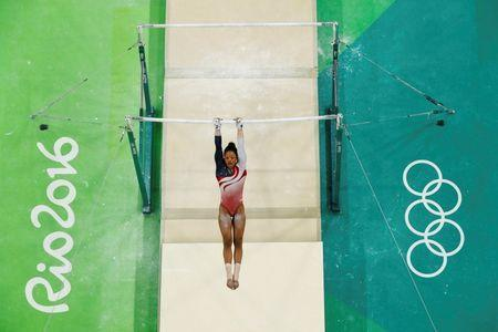 2016 Rio Olympics - Artistic Gymnastics - Final - Women's Team Final - Rio Olympic Arena - Rio de Janeiro, Brazil - 09/08/2016. Gabrielle Douglas (USA) of USA (Gabby Douglas) competes on the uneven bars during the women's team final. REUTERS/Fabrizio Bensch