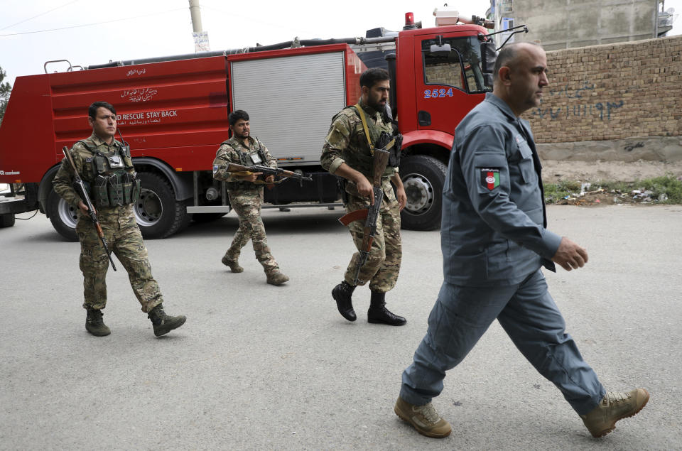 Security personnel arrive at the site of a rocket attack in Kabul, Afghanistan, Tuesday, July 20, 2021. At least three rockets hit near the presidential palace on Tuesday shortly before Afghan President Ashraf Ghani was to give an address to mark the Muslim holiday of Eid-al-Adha. (AP Photo/Rahmat Gul)