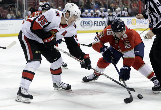 Ottawa Senators' Matt Duchene (95) and Florida Panthers' Aleksander Barkov (16) go for the puck on a face off during the first period of an NHL hockey game, Monday, March 12, 2018, in Sunrise, Fla. (AP Photo/Lynne Sladky)