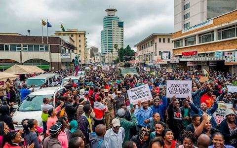 Protesters demanding the resignation of Robert Mugabwe in Harare - Credit: AFP