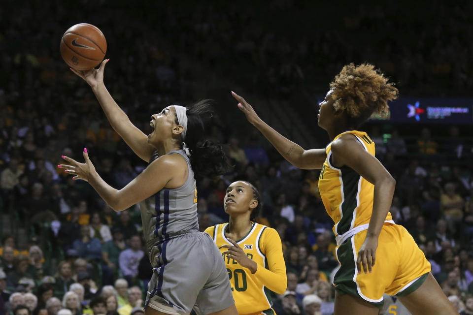 West Virginia guard Kysre Gondrezick, left, scores past Baylor guard DiDi Richards, right, in the first half of an NCAA college basketball game, Saturday, Jan. 18, 2020, in Waco, Texas. (AP Photo/Rod Aydelotte)