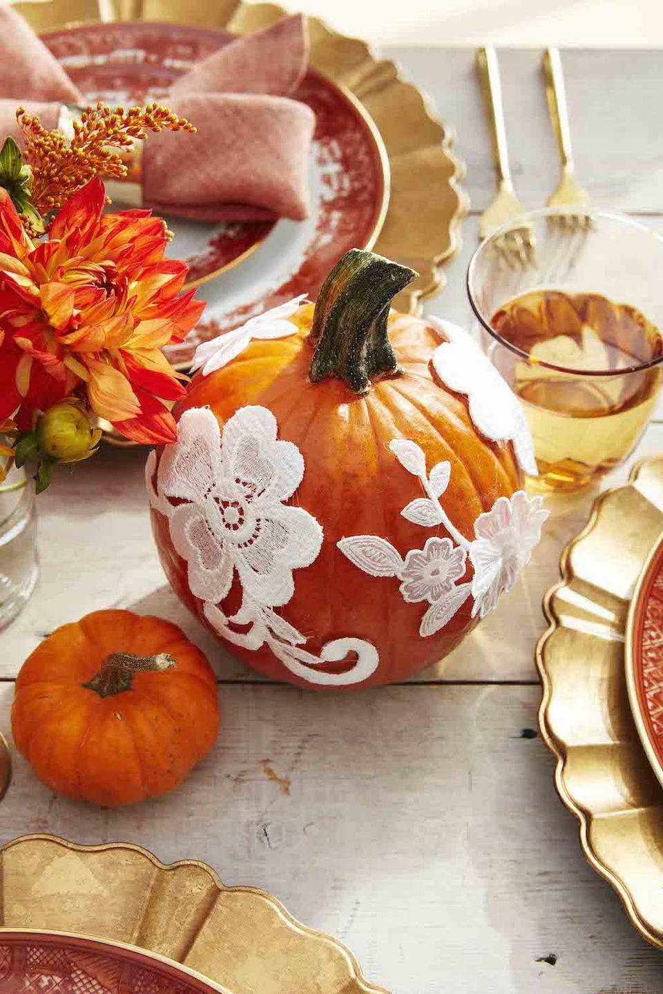 """<p>Add some flair to traditional orange pumpkins by detailing them with white lace appliqué. This pumpkin decorating idea is a less messy alternative to carving.</p><p><a class=""""link rapid-noclick-resp"""" href=""""https://www.amazon.com/Floral-Applique-Sequins-Embroidery-Craft/dp/B01NAQ1IZ0/?tag=syn-yahoo-20&ascsubtag=%5Bartid%7C10050.g.3739%5Bsrc%7Cyahoo-us"""" rel=""""nofollow noopener"""" target=""""_blank"""" data-ylk=""""slk:SHOP WHITE LACE"""">SHOP WHITE LACE</a></p>"""