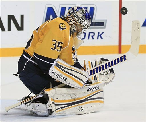 Nashville Predators goalie Pekka Rinne (35), of Finland, blocks a shot against the Columbus Blue Jackets in the first period of an NHL hockey game on Thursday, Dec. 22, 2011, in Nashville, Tenn. (AP Photo/Mark Humphrey)