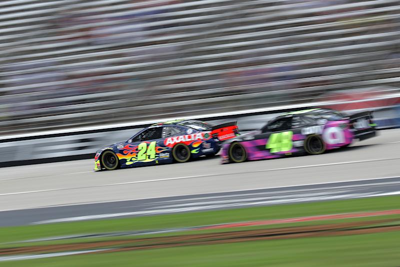 FORT WORTH, TEXAS - JULY 19: William Byron, driver of the #24 Axalta Chevrolet, leads Jimmie Johnson, driver of the #48 Ally Chevrolet, during the NASCAR Cup Series O'Reilly Auto Parts 500 at Texas Motor Speedway on July 19, 2020 in Fort Worth, Texas. (Photo by Chris Graythen/Getty Images)