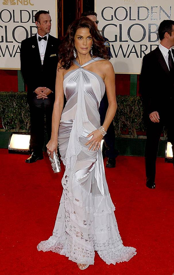"Teri Hatcher looked ""desperate"" for attention in this busy silver getup worn in 2005. Perhaps we're distracted by her over-bronzed skin, Farrah hair, and extreme use of rouge? Carlos Diaz/<a href=""http://www.infdaily.com"" target=""new"">INFDaily.com</a> - January 16, 2005"