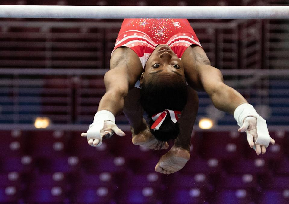 Simone Biles practices on the uneven bars at U.S. Olympic trials.