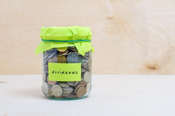 "A jar with a label on it that reads: ""dividends"""