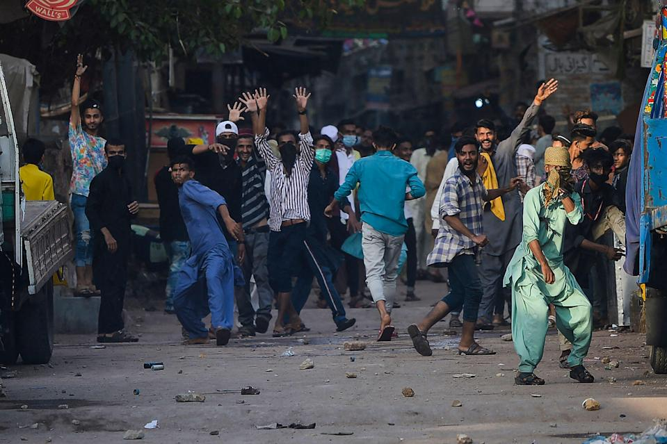 TLP supporters pelt stones in Karachi on Monday after a nationwide shutdown was announcedAFP via Getty Images
