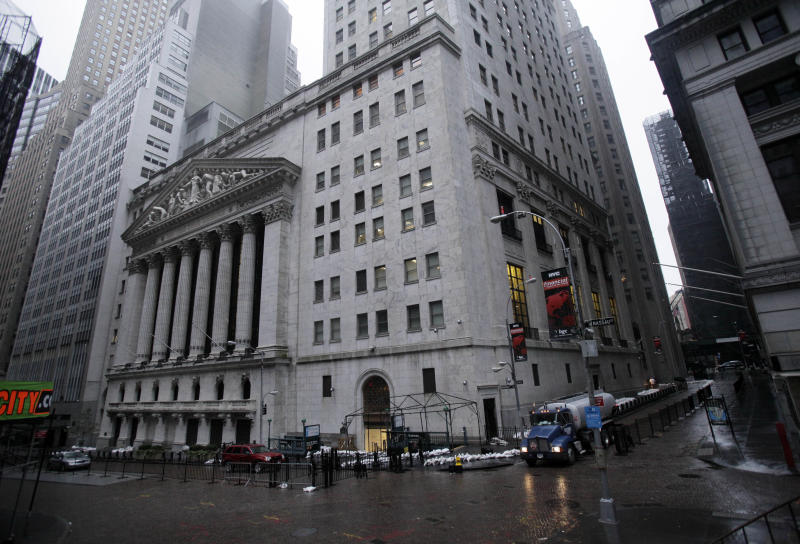 The streets surrounding the New York Stock Exchange are deserted as financial markets remain closed for the second day due to superstorm Sandy, Tuesday, Oct. 30, 2012. Sandy, the storm that made landfall Monday, caused multiple fatalities, halted mass transit and cut power to more than 6 million homes and businesses. (AP Photo/Richard Drew)