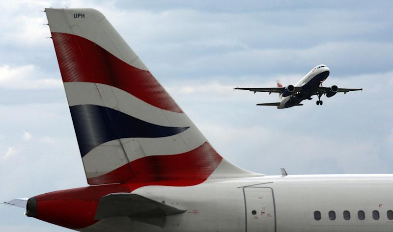 A British Airways plane takes off from Heathrow Airport, flying over another BA plane as BA cabin staff continue their strike action. (Photo by Steve Parsons/PA Images via Getty Images)
