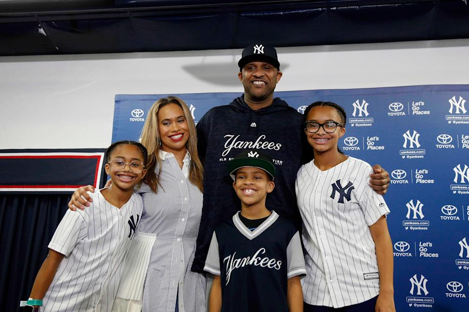 New York Yankees starting pitcher CC Sabathia (52) poses with his family (left to right) daughter Cyia, wife Amber, son Carter and daughter Jaeden as he formally announced that he will be retiring after this season during spring training camp at George M. Steinbrenner Field.