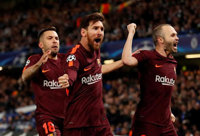 Soccer Football - Champions League Round of 16 First Leg - Chelsea vs FC Barcelona - Stamford Bridge, London, Britain - February 20, 2018 Barcelona's Lionel Messi celebrates scoring their first goal with Andres Iniesta (R) and Jordi Alba (L) Action Images via Reuters/Andrew Boyers