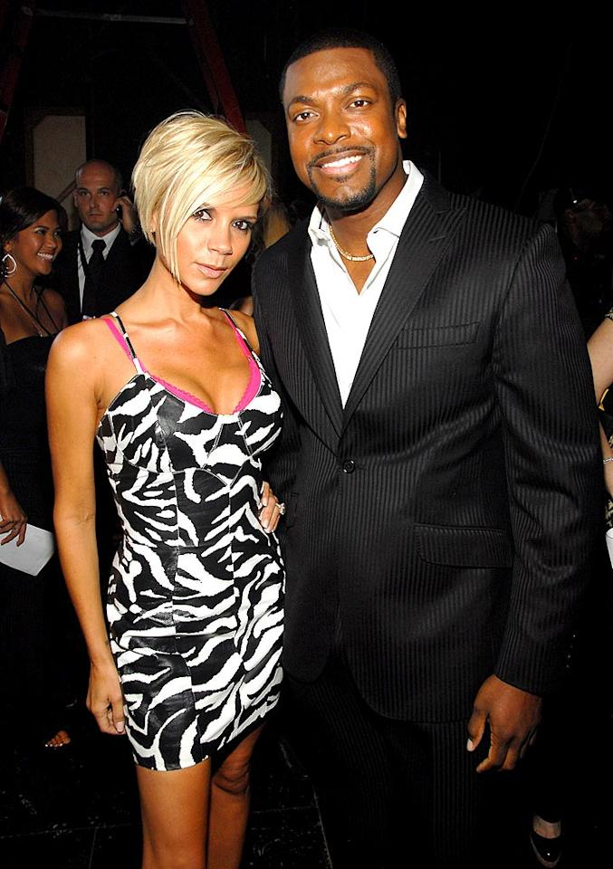"""Victoria Beckham keeps it sexy in a leopard print dress with Chris Tucker. Kevin Mazur/<a href=""""http://www.wireimage.com"""" target=""""new"""">WireImage.com</a> - June 3, 2007"""