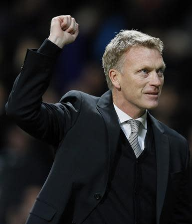 Manchester United's manager David Moyes reacts after their Champions League soccer match against Shakhtar Donetsk at Old Trafford in Manchester, northern England December 10, 2013. REUTERS/Phil Noble