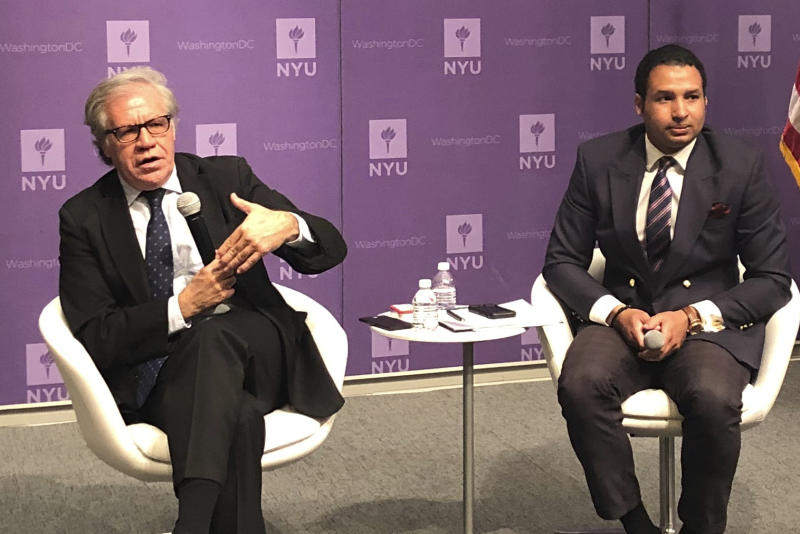 Secretary General of the Organization of American States, Luis Almagro, left, talks to Geovanny Vicente Romero during an event held at the Washington campus of New York University on Wednesday April 24, 2019. (AP Photo/Luis Alonso Lugo)