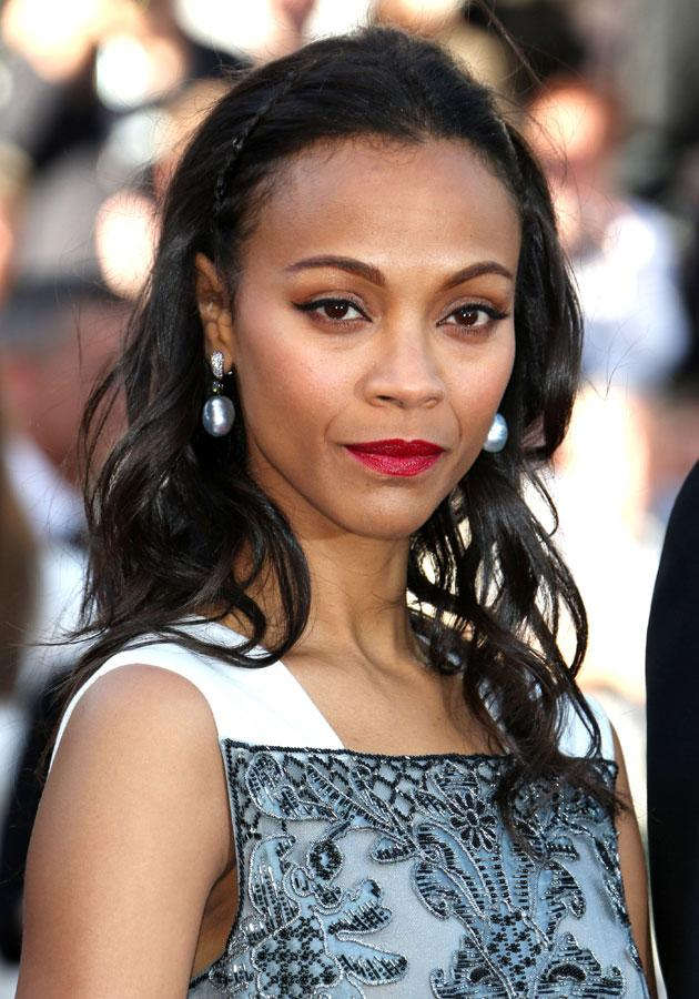Celebrities wearing red lipstick: Zoe Saldana worked the red lips trend at Cannes.[Rex]