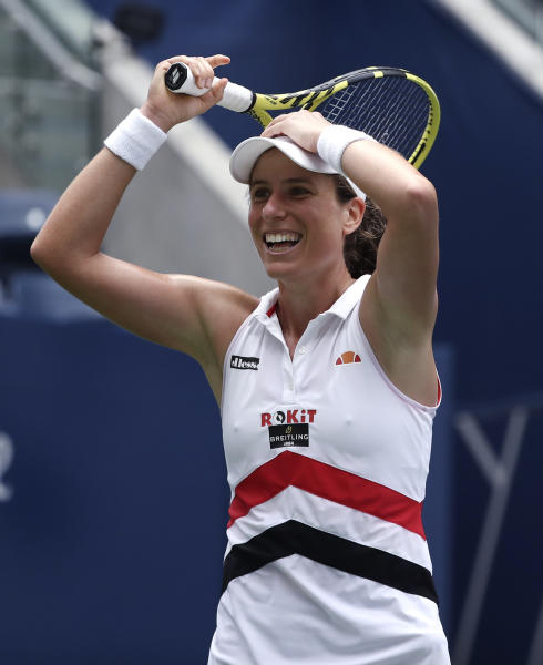 Johanna Konta, of the United Kingdom, reacts after defeating Karolina Pliskova, of the Czech Republic, during round four of the US Open tennis championships Sunday, Sept. 1, 2019, in New York. (AP Photo/Kevin Hagen)