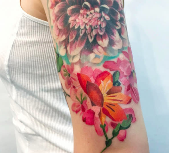 OMG this artist uses *real* flowers to create tattoos, and we are obsessed
