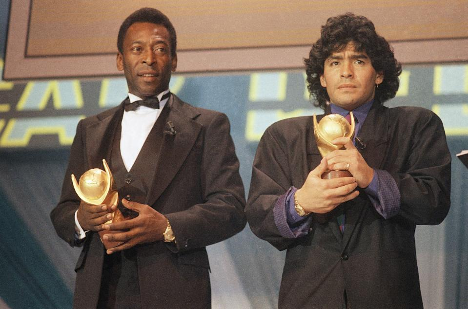 """Pele and Maradona seen together in Italy in March 1987 as they received the trophy of """"Sports Oscar"""" for their performance in the soccer fields. (AP Photo/Milan)"""