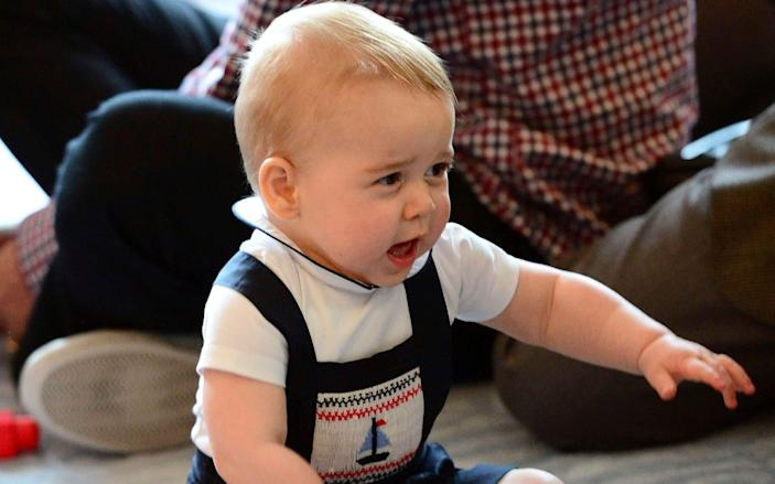 Prince George wearing the Sailboat Smocked Dungarees in New Zealand in 2014 - James Whatling/Reuters