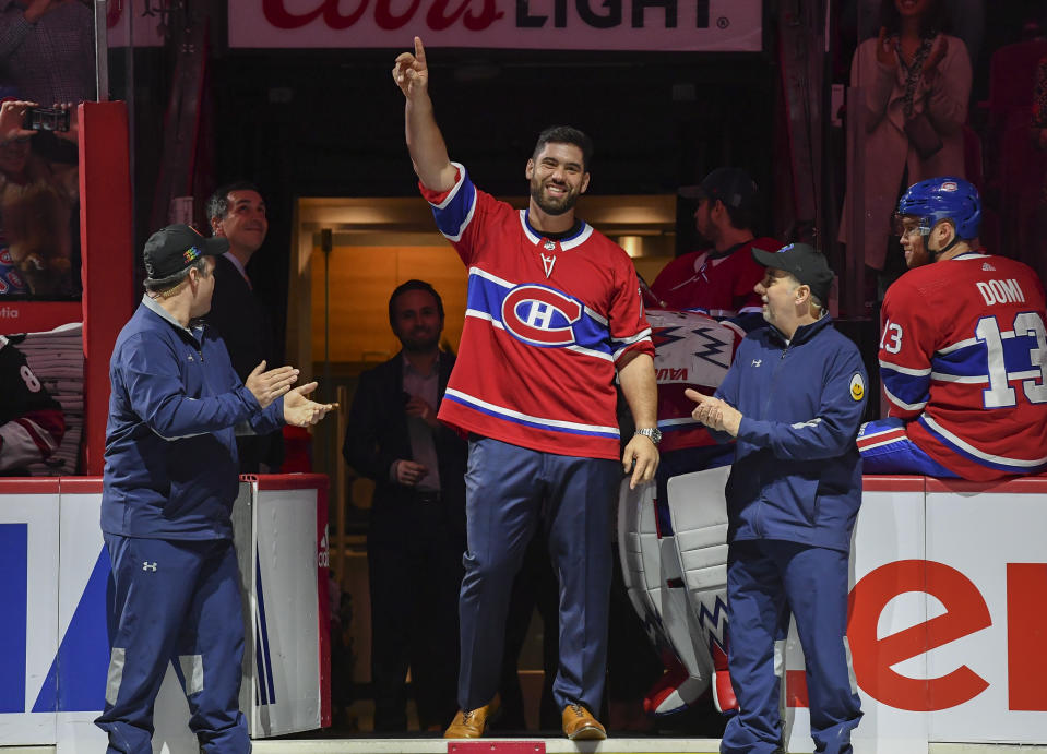 MONTREAL, QC - FEBRUARY 10: Canadian football player Laurent Duvernay-Tardif greets the fans in a ceremony prior to the NHL game between the Montreal Canadiens and the Arizona Coyotes at the Bell Centre on February 10, 2020 in Montreal, Quebec, Canada. (Photo by Francois Lacasse/NHLI via Getty Images)