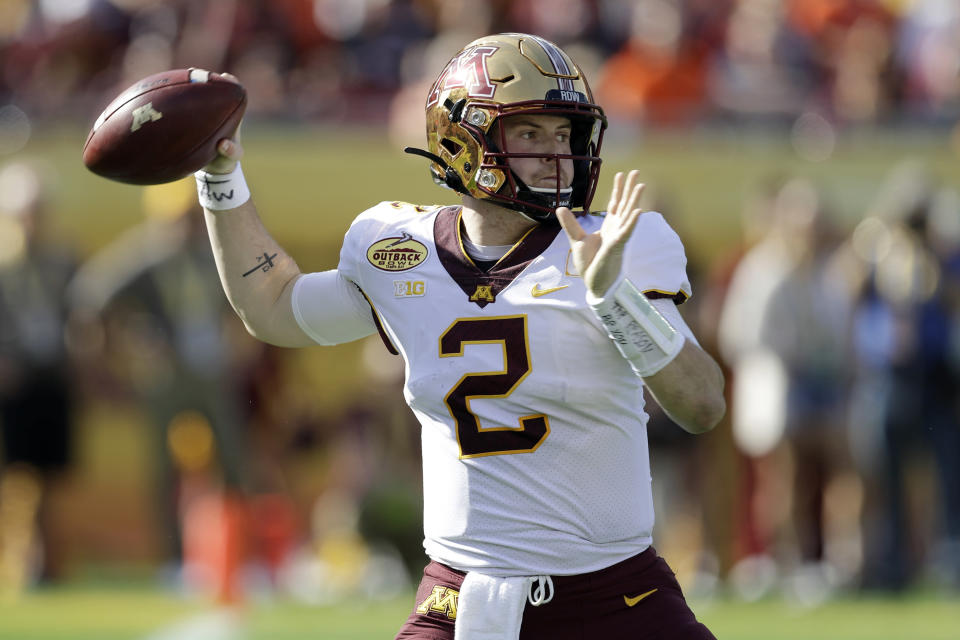 Minnesota quarterback Tanner Morgan (2) throws a pass against Auburn during the first half of the Outback Bowl NCAA college football game Wednesday, Jan. 1, 2020, in Tampa, Fla. (AP Photo/Chris O'Meara)