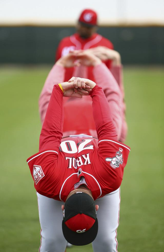 Cincinnati Reds pitcher Ian Krol joins other teammates as they stretch during workouts at the Reds spring training baseball facility, Wednesday, Feb. 13, 2019, in Goodyear, Ariz. (AP Photo/Ross D. Franklin)
