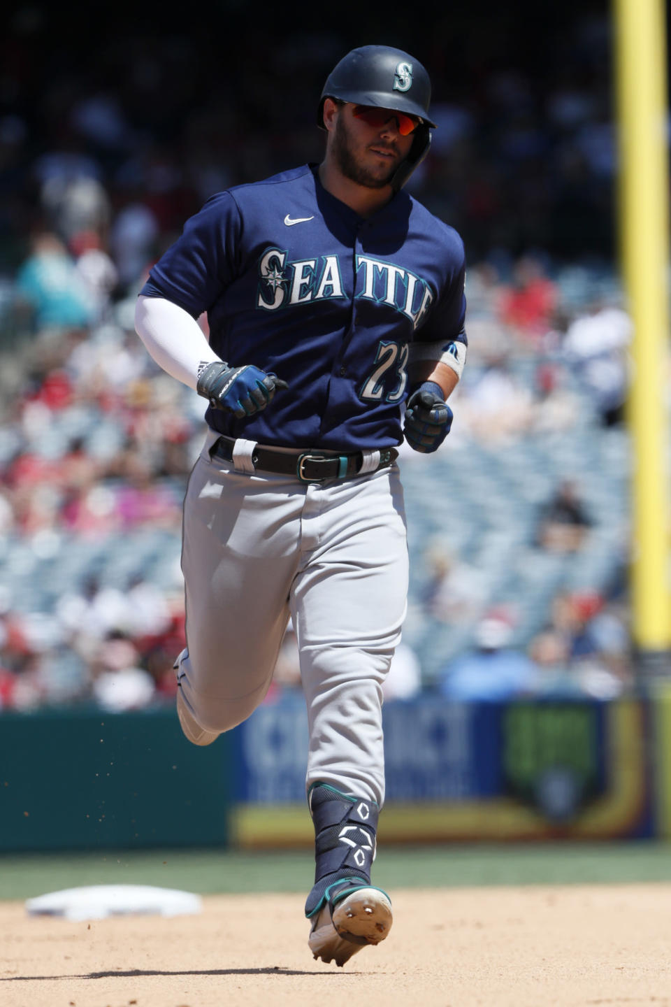 Seattle Mariners' Ty France rounds the bases after hitting a three-run home run against the Los Angeles Angels during the fifth inning of a baseball game in Anaheim, Calif., Sunday, July 18, 2021. (AP Photo/Alex Gallardo)