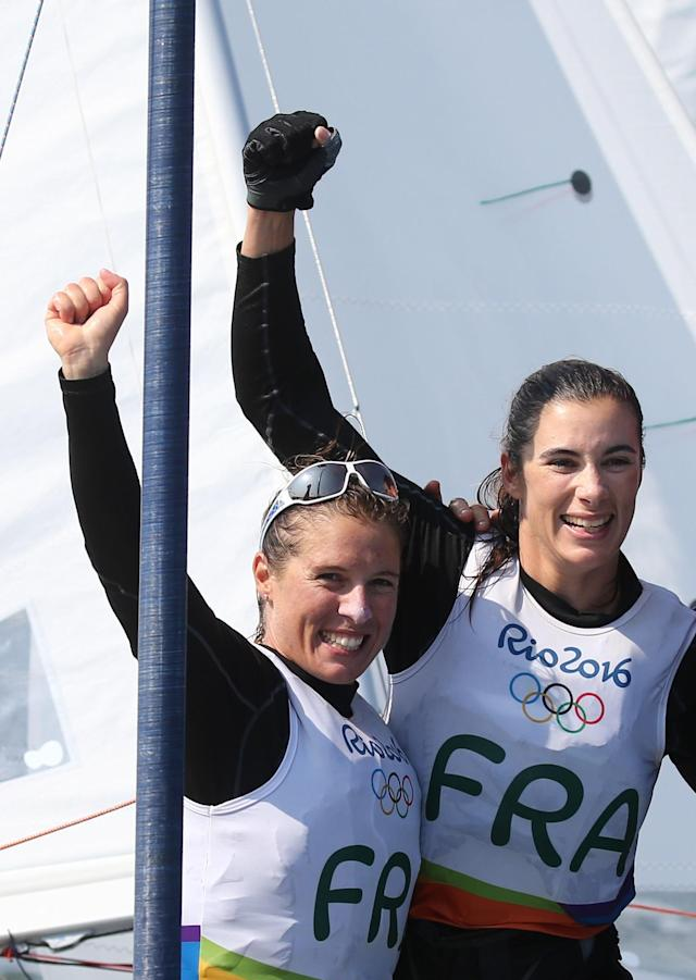 2016 Rio Olympics - Sailing - Final - Women's Two Person Dinghy - 470 - Medal Race - Marina de Gloria - Rio de Janeiro, Brazil - 18/08/2016. Camille Lecointre (FRA) of France and Helene Defrance (FRA) of France celebrate bronze medal. REUTERS/Benoit Tessier FOR EDITORIAL USE ONLY. NOT FOR SALE FOR MARKETING OR ADVERTISING CAMPAIGNS.