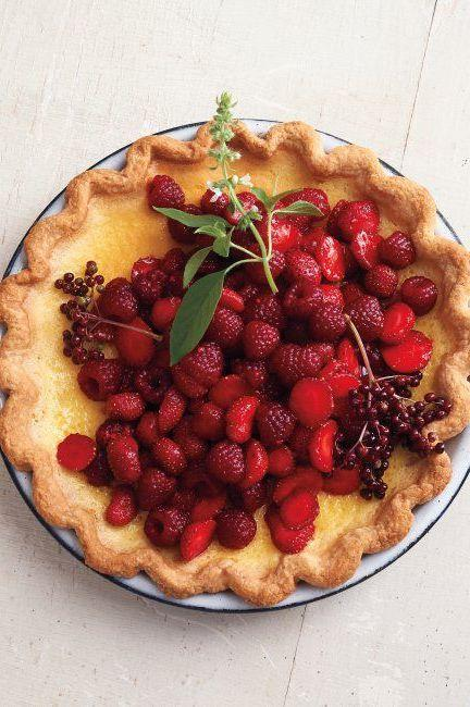 """<p>A few handfuls of raspberries, strawberries, and elderberries tossed in sugar rest atop a chilled custard infused with lemon basil. The herb, with its citrusy note, brightens the silky, rich filling.</p><p>Get the <a href=""""https://www.delish.com/uk/cooking/recipes/a32943307/lemon-basil-custard-pie-red-berries/"""" target=""""_blank"""">Lemon-Basil Custard Pie with Red Berries</a> recipe.</p>"""