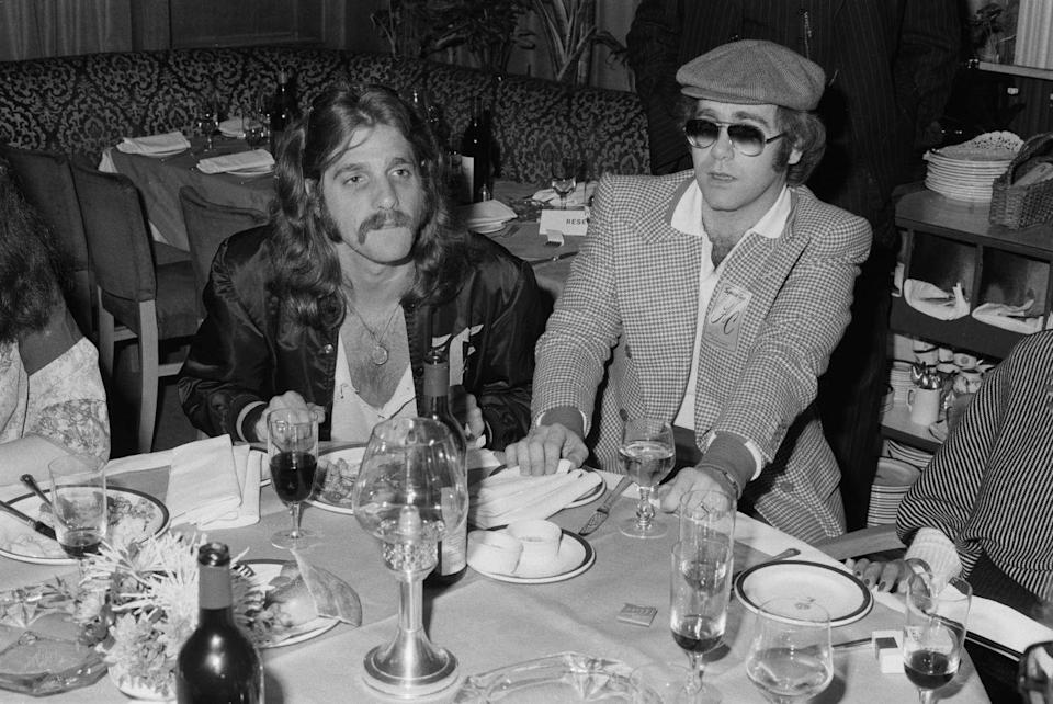 <p>Glenn Frey with Elton John at a party thrown by The Eagles on April 26, 1977.</p>