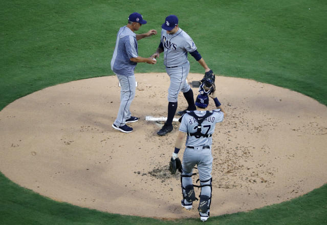 Tampa Bay Rays manager Kevin Cash, top left, takes the ball from starting pitcher Andrew Kittredge, right, as catcher Travis d'Arnaud (37) looks on in the first inning of a baseball game in Arlington, Texas, Wednesday, Sept. 11, 2019. (AP Photo/Tony Gutierrez)