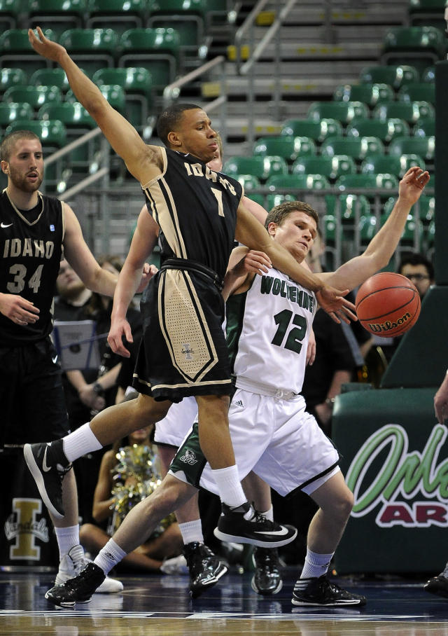 Idaho's Glen Dean (1) and Utah Valley's Holton Hunsaker go for the ball during the second half of an NCAA college men's basketball game in the semifinals of the West Athletic Conference tournament Friday, March 14, 2014, in Las Vegas. Idaho won 74-69. (AP Photo/David Becker)